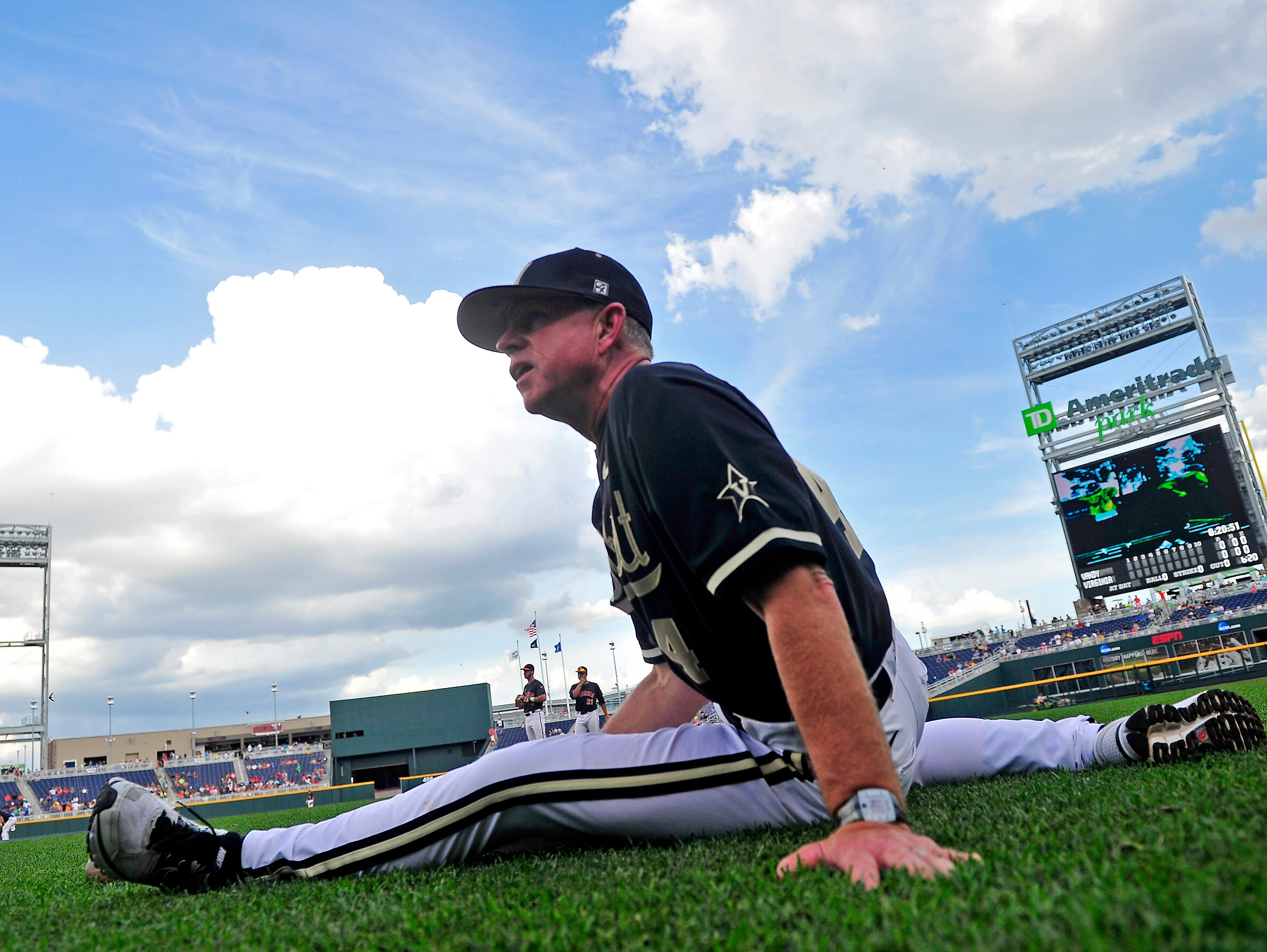 Vanderbilt Head Coach Tim Corbin stretches prior to the game 3 against Virginia at the College World Series at TD Ameritrade Park in Omaha, Neb., Wednesday, June 25, 2014.
