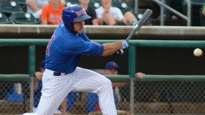 Matt Szczur takes a swing at a pitch during an Iowa Cubs game in 2014.