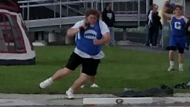 Danbury's Kain Lucas competes in the shot put at the Toledo Area Athletic Conference Championships. Lucas established a school-record while winning the event.