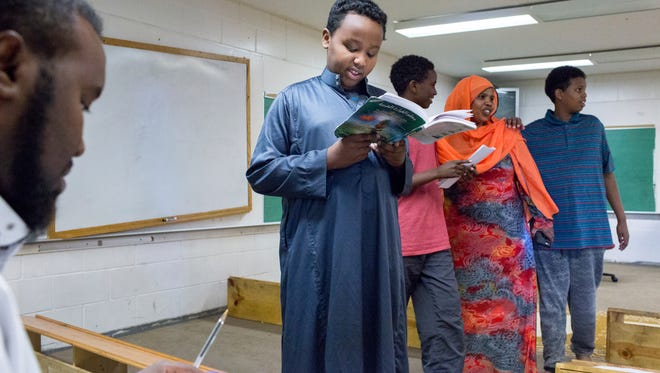 Yacqub Hashi, 11, recites vocabulary in Arabic to Muse Hussein, left, during class at the Dar Al Farooq Islamic Center, on Monday, Aug. 7, 2017, in Bloomington, Minn. The head of the Minneapolis FBI office says the investigation into the weekend bombing of the mosque is their top priority and they going to focus every available resource on the case until it's solved. Nobody was hurt in the explosion, which happened just before morning prayers on Saturday at the mosque.