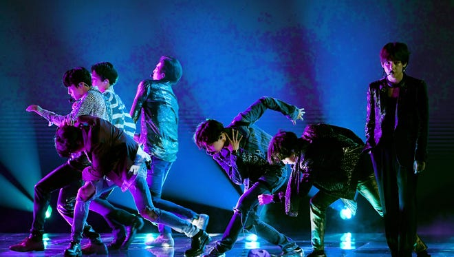 The boy band BTS performs at the 2018 Billboard Music Awards, where they won for top social artist.