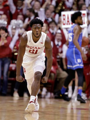 Indiana forward Freddie McSwain Jr. celebrates a dunk against Duke during the first half of an NCAA college basketball game, Wednesday, Nov. 29, 2017, in Bloomington, Ind.