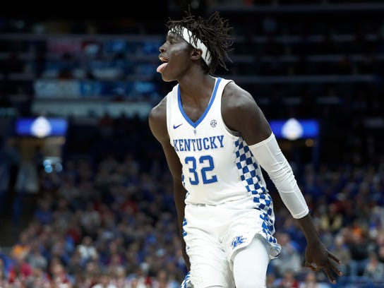 Kentucky's Wenyen Gabriel celebrates after making a thee-point basket during the second half of an NCAA college basketball semifinal game against Alabama at the Southeastern Conference tournament Saturday, March 10, 2018, in St. Louis. Kentucky won 86-63. (AP Photo/Jeff Roberson)