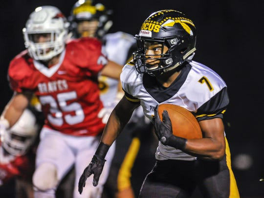 Piscataway running back Nasir Best breaks free for extra yards during a game on Friday against Manalapan in Manalapan on Oct. 27, 2017.