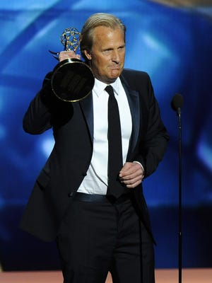"Jeff Daniels accepts the award for outstanding lead actor in a drama series in September 2013 for his role on ""The Newsroom."" Chris Pizzello/Invision/AP"