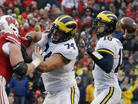 Michigan quarterback Brandon Peters throws during the