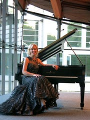 PIanist Olga Kern at the Van Cliburn Concert Steinway Grand Piano she played at the Crystal Bridges inaugural  concert.