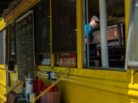 Owner Jay LaShombe prepares a lunch order at Beansie's