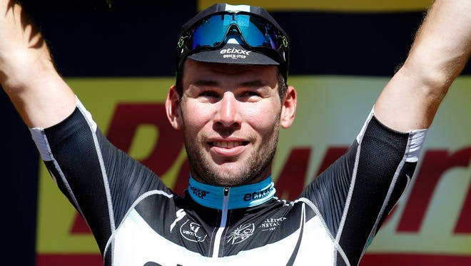 Mark Cavendish of Britain celebrates on the podium after winning the 7th stage of the 102nd edition of the Tour de France on July 10, 2015.