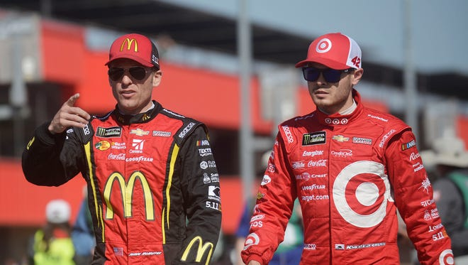 Kyle Larson, right, leads the NASCAR Cup Series standings, while teammate Jamie McMurray, left, sits in fifth.