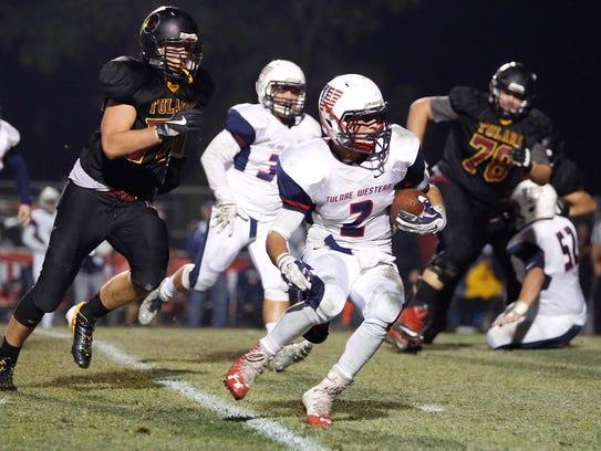 Tulare Western's David Alcantar carries the football