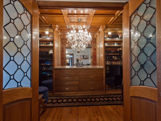 A set of double leaded glass doors lead into the luxurious