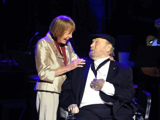 Jo Walker-Meador, left, inducts Mac Wiseman into the Country Music Hall of Fame during the medallion ceremony Oct. 26, 2014.