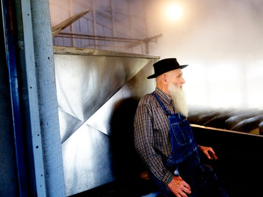 John Guenther takes a seat in the Muddy Pond Sorghum Mill, outside of Monterey, Tennessee on Tuesday, September 19, 2017.