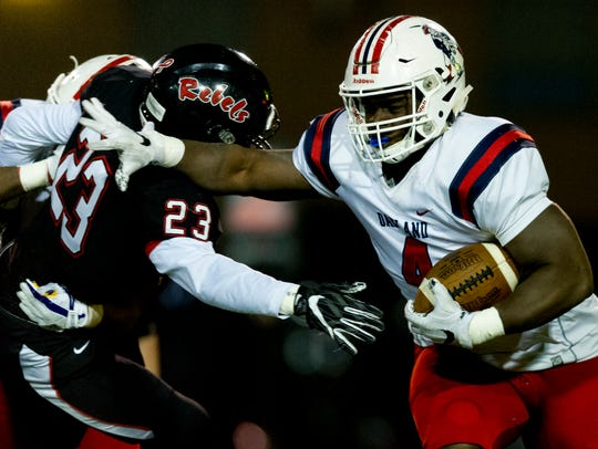 Oakland's Lontavious Wilson (4) pushes away Maryville's