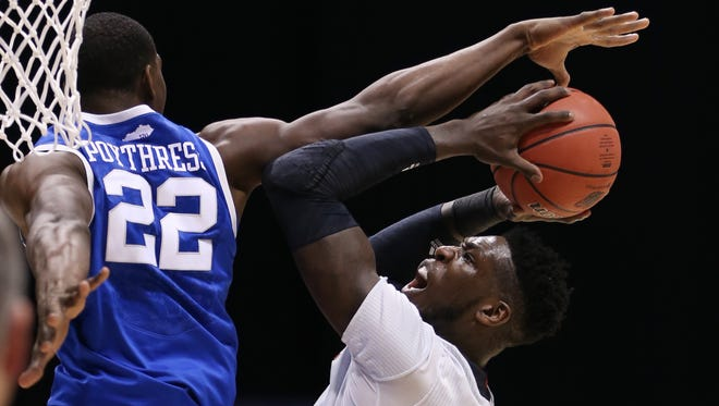 Louisville's Montrezl Harrell goes up for a shot only to be fouled by Kentucky's Alex Poythress in the first half.