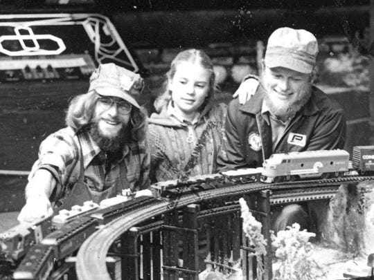 Steven Clarke, left, pictured with Brandywine River Musem of Art's train display and two assistants. Clarke held the position of Brandywine's model train coordinator for more than 40 years. 1978.