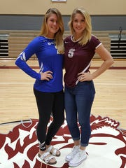 Sisters Liz (left) and Danielle Bradley pose for a picture in the First Baptist Academy gym. Liz is a sophomore volleyball player at Barron Collier, while Danielle is a senior volleyball player at FBA. Both teams are playing for state championships this week.