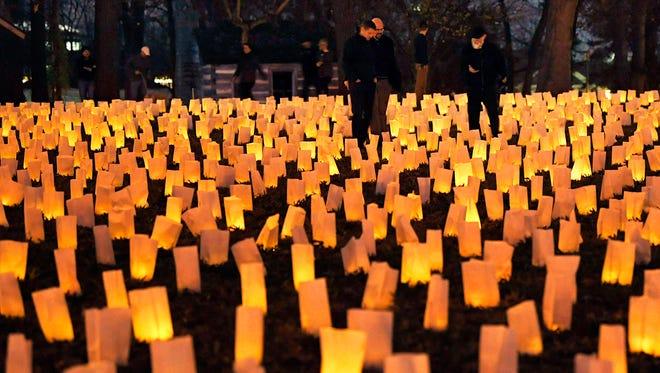 Each year on November 30th, The Battle of Franklin Trust hosts the annual illumination where ten thousand luminaries are laid out to represent the 10,000 casualties from the Battle of Franklin in 1864. People walk among the luminaries during the 153rd Anniversary of the Battle of Franklin and Illumination at the Carter House on Thursday, Nov. 30, 2017.