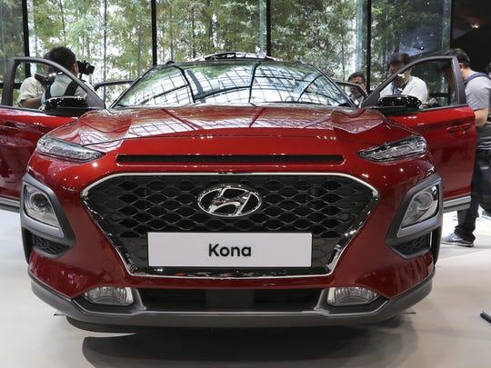 Members of media and visitors surround Hyundai Motor's
