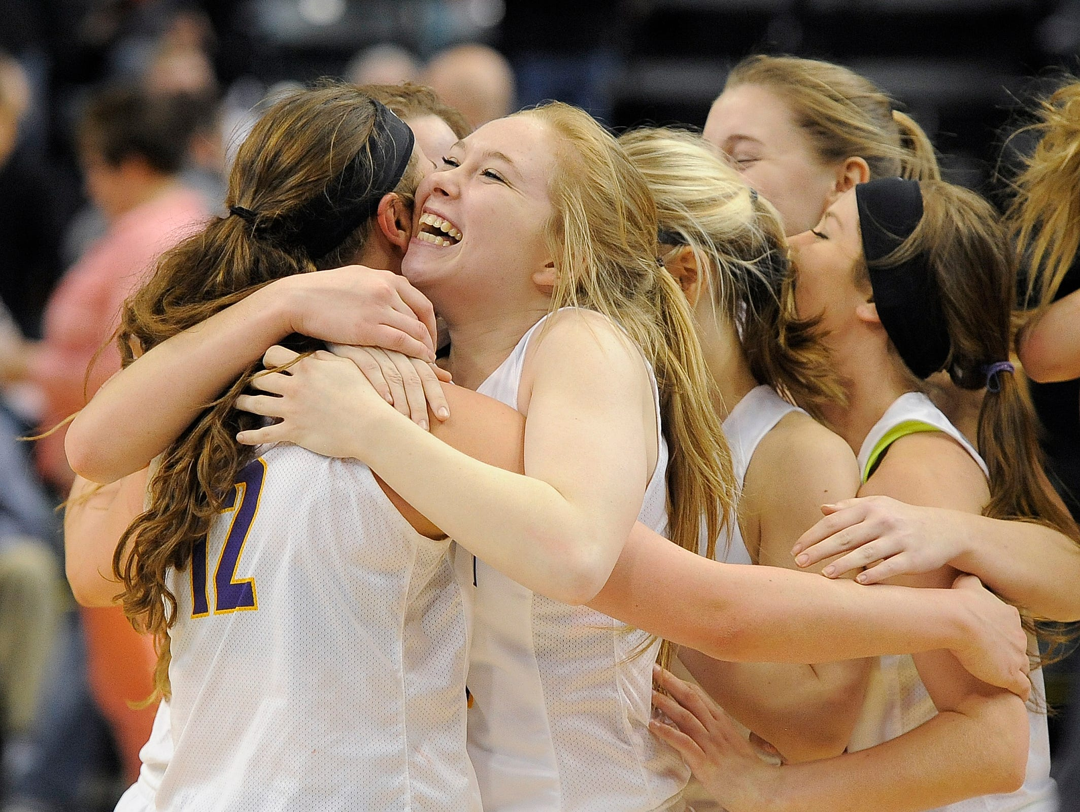 Eastern Pekin's Holly Purlee (center) celebrates with teammates afert defeating Oak Hill on Saturday in the 2017 IHSAA 2A Girls Basketball State Championship at Bankers Life Fieldhouse in Indianapolis. It was Eastern Pekin's first state championship. (Photo by David Lee Hartlage, Special to The Courier-Journal) Feb. 25, 2017
