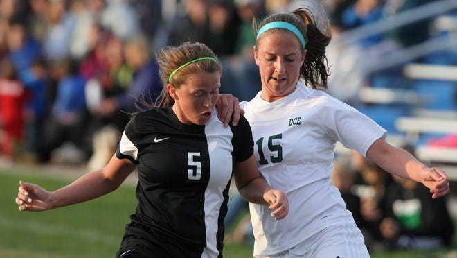 SPASH's Brooklyn Seefeldt, left, and D.C. Everest's Kaylee Heil and battle in close quarters for the ball during a Wisconsin Valley Conference soccer match Tuesday at the D.C. Everest soccer complex in Weston.