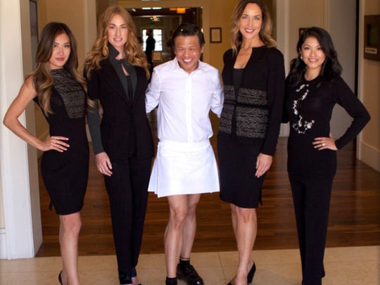 Designer Zang Toi with the collection he's created