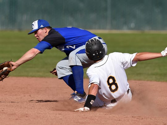 Galena's Tommy Lichty slides into second base as Carson's Jace Keema catches the ball in Tuesday's game Lichty was called safe in the play.