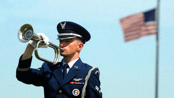 Airman 1st Class Benjamin Larrabee, a member of the Dyess Air Force Base Honor Guard, plays Taps on the bugle during the Memorial Day ceremony on Monday, May 29, 2017, at the Texas State Veterans Cemetery at Abilene.