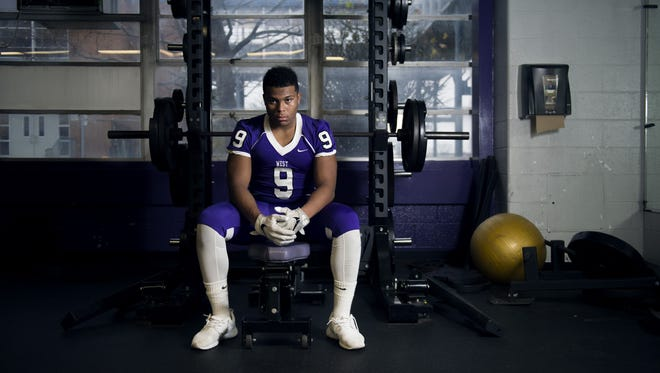 Defensive Player of the Year Lorenzo Hernandez of Cherry Hill West poses in the school's weight room Tuesday, Dec. 6 in Cherry Hill.