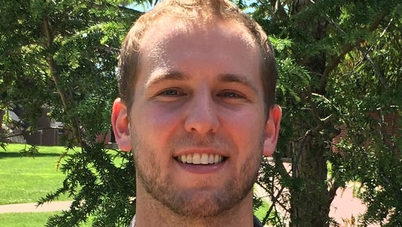 West Henderson alum Zach Corliss has been hired as