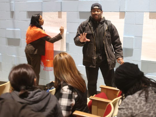 Tron Melton leads one of the break-out groups as they talk about ways to combat bullying during the Poughkeepsie Middle Model School Family University Dec. 9, 2017.