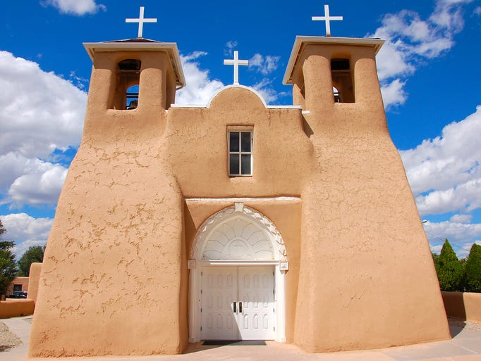 Taos, N.M., is famous for its traditional adobe                                                           architecture,                                                          w