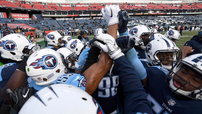 The Titans huddle before the start of the game against the Jaguars at Nissan Stadium Sunday, Dec. 31, 2017 in Nashville, Tenn.