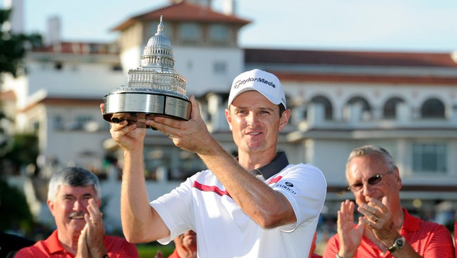 Justin Rose poses with the trophy after he won the Quicken Loans National on Sunday, June 29, 2014, in Bethesda, Md.