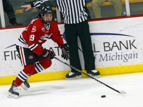 St. Cloud State forward Mikey Eyssimont handles the