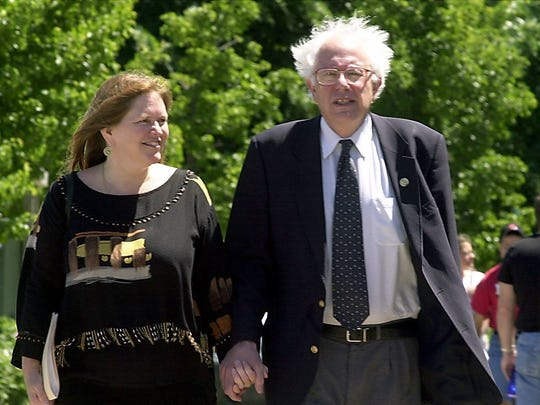 U.S. Sen. Bernie Sanders, I-Vt., walks with his wife, Jane, in 2002. Sanders is criticizing Skip Vallee for launching an attack ad against the couple.