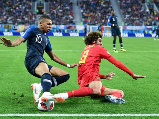 France forward Kylian Mbappe  attempts to pass the