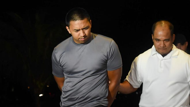 Department of Corrections Officer Shane Anthony Keokolo Cruz, 22, of Sinajana is escorted at the Guam Police Department Hagåtña Precinct Command on Sept. 7, 2017. Cruz was arrested for official misconduct, conspiracy and promoting major prison contraband, according to GPD Officer A.J. Balajadia.