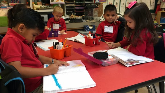 Myrtle Cooper Elementary School students color a picture