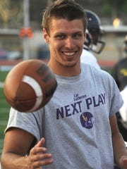 CLU wide receiver Aaron Lacombe catches a ball on the sidelines during a scrimmage against Moorpark College on Aug.  25.