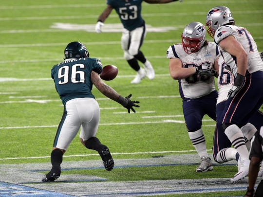 Philadelphia Eagles defensive end Derek Barnett (96) recovers a fumble during the fourth quarter against the New England Patriots in Super Bowl LII at U.S. Bank Stadium on Feb. 4, 2018.