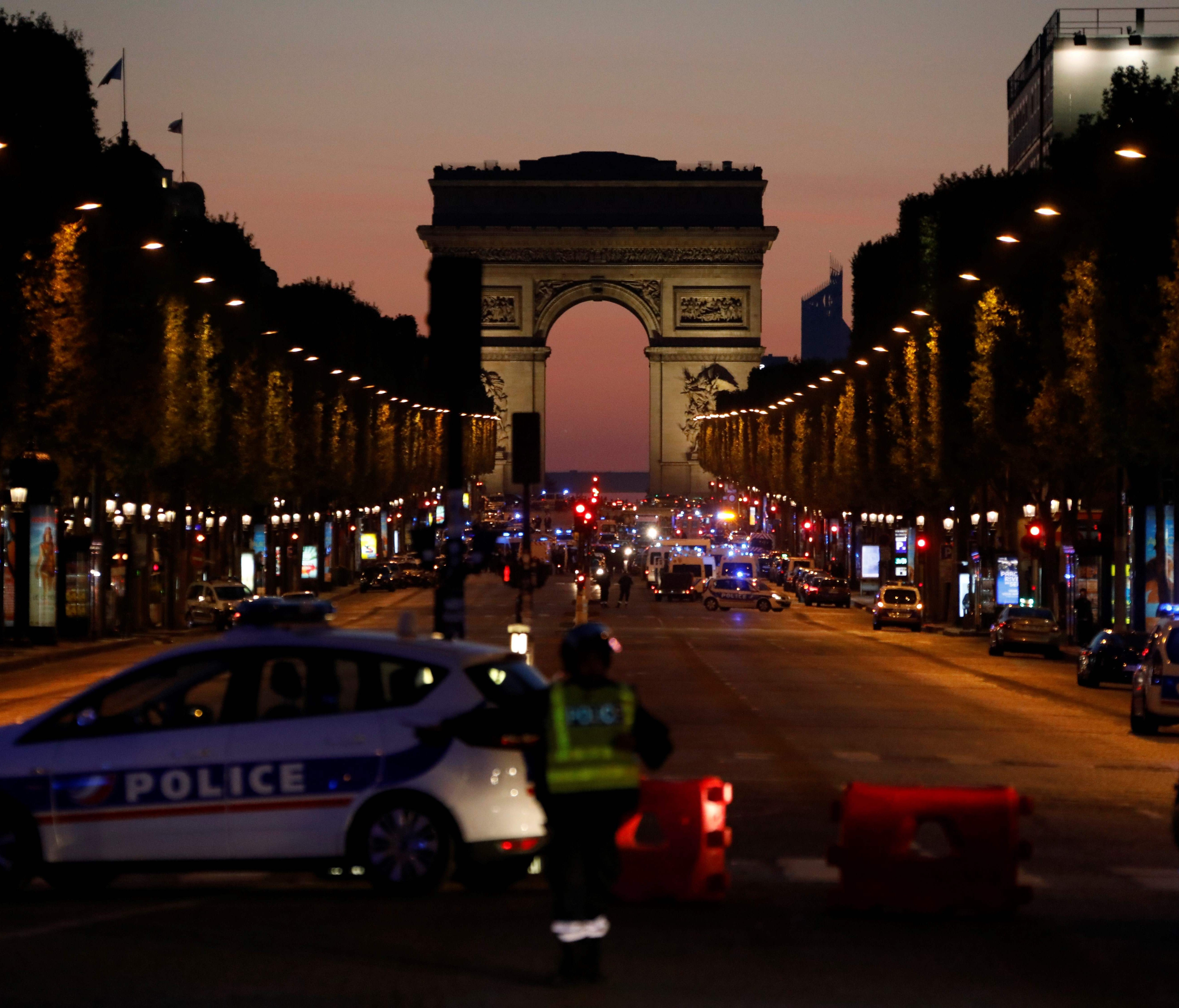 Police officers block the access to the Champs-Elysees after one police officer was killed and two other people wounded in a shooting on Thursday.