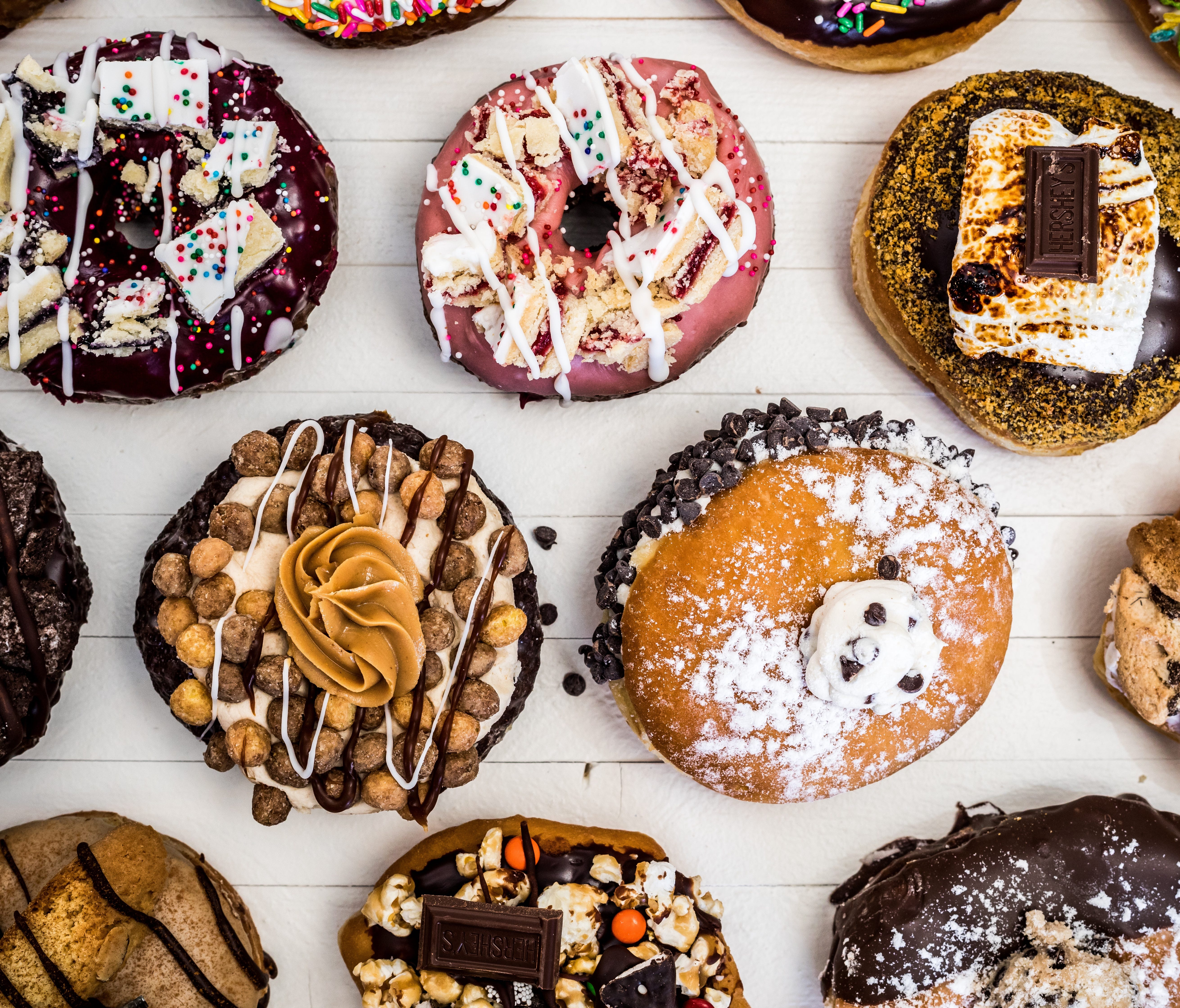 At four Connecticut locations, Donut Crazy crafts more than 20 over-the-top takes on doughnuts with toppings such as chopped peaches rolled in sugar or a piece of Double Bubble gum.