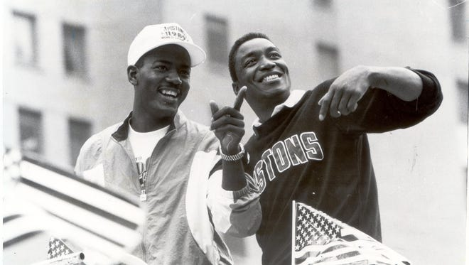 Joe Dumars, left, and Isiah Thomas during the Pistons' victory parade in Detroit on June 15, 1989.