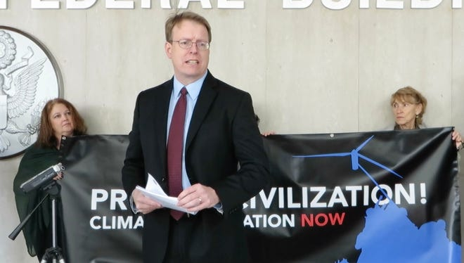 "Sen. Robert Hogg, D-Cedar Rapids, speaks Thursday at a  ""Climate Mobilization"" rally at the Neal Smith Federal Building in downtown Des Moines"