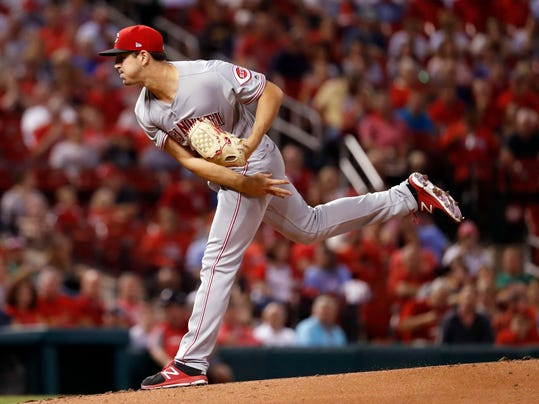 Cincinnati Reds starting pitcher Tyler Mahle watches a throw during the first inning of a baseball game against the St. Louis Cardinals on Wednesday, Sept. 13, 2017, in St. Louis. (AP Photo/Jeff Roberson)
