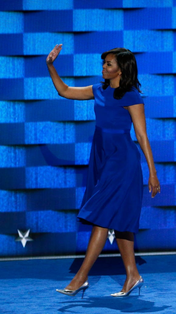 Michelle Obama speaks on the first day of the Democratic