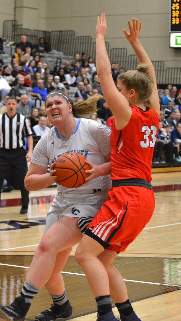 Saddle River Day sophomore forward Jenna Jordan defending Immaculate Conception senior center Danielle Deoul in the third-seeded Rebels' 51-39 win over No. 1 Immaculate Conception in the Bergen County tournament final on Sunday.