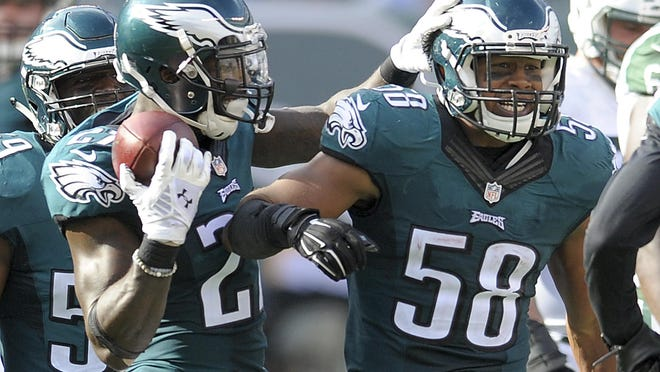 Eagles linebacker Jordan Hicks (right) had 54 tackles, two interceptions and three fumble recoveries in just eight games last season.